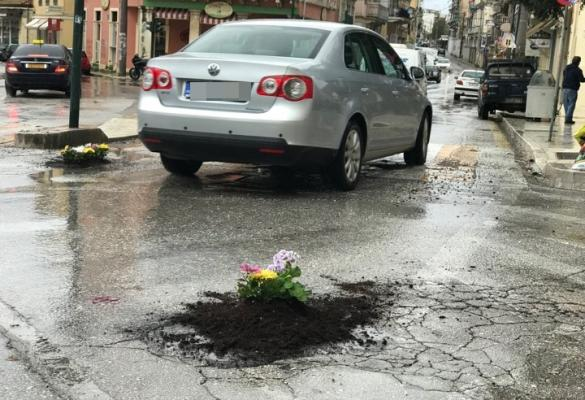 Flowers planted in potholes this morning!